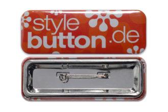 rechteckiger Button 70 x 25 mm mit Sicherheitsnadel