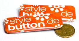 rechteckige Buttons im Größenvergleich zu 50 ct Münze