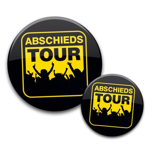 JGA Buttons Abschiedstour gelb schwarz feiernde Leute