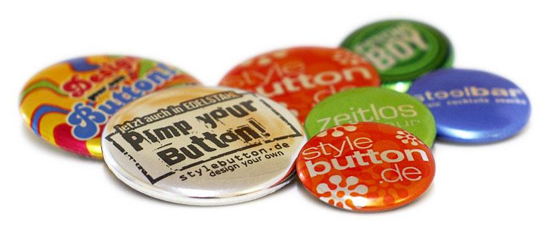 Beispiele für Buttons in Metallic 4/0 Druckqualität
